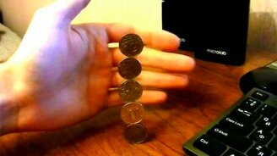 Смотреть Трюк с пятью монетами