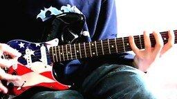 Смотреть Интересный способ игры на гитаре