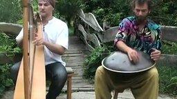 Смотреть Дуэт арфы и барабана-ханга