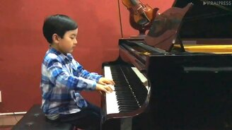 Семилетний пианист смотреть видео - 0:53